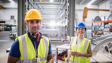 Man and Woman in hard hats